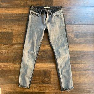 Levi's two-tone black grey raw hem jeans